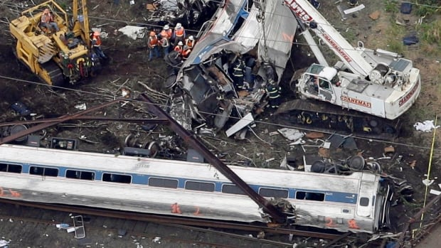 Emergency personnel work at the scene of a deadly train wreck on Wednesday in Philadelphia. More than 200 people aboard the Washington-to-New York train were injured in the derailment on Tuesday night.
