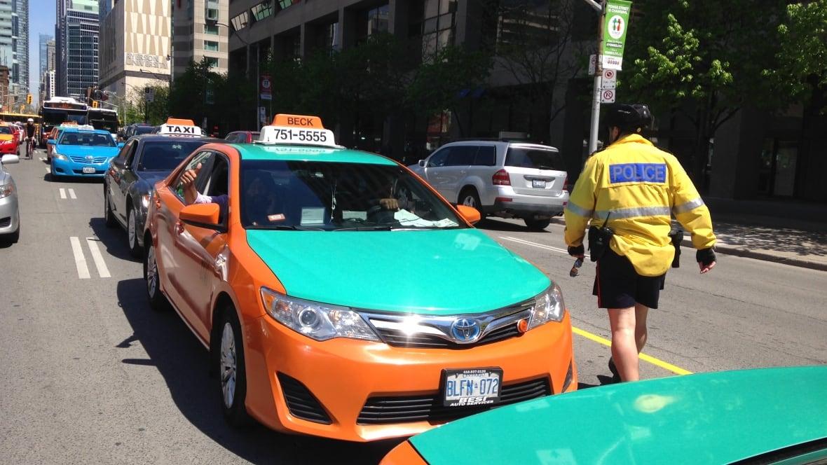 Checker Cab London >> Uber-protesting Toronto taxi drivers block streets around ...