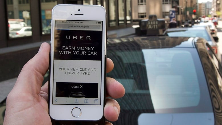 Uber montreal offices searched by revenu québec cbc news
