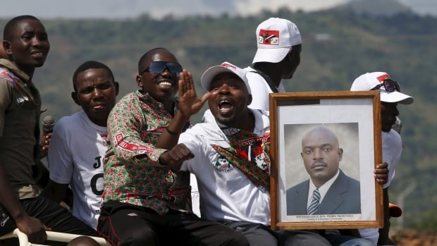 Supporters of Burundi President Pierre Nkurunziza carry his picture. His spokesman said Friday that the coup leader had been detained but later said Maj.-Gen. Godefroid Niyombare is still at large.