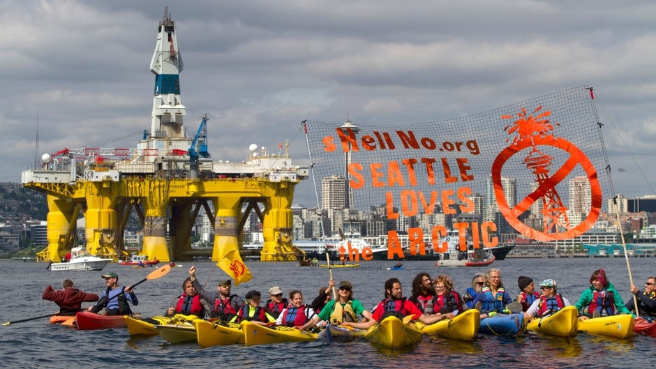 Environmental activists in a kayak flotilla protest the arrival of the Polar Pioneer, an oil drilling rig owned by Shell Oil, on May 14, 2015 in Seattle, Washington. The rig is part of a fleet that will lead a controversial oil-exploration effort off Alaska's North Slope.