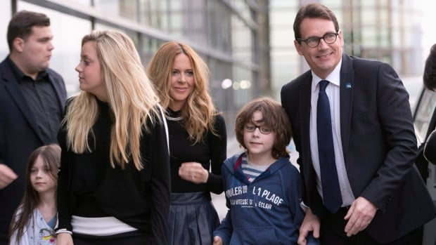 In happier times, Pierre-Karl Péladeau arrives with his family, from the left, Romy, Marie, his wife Julie Snyder and son Thomas to hear leadership vote results in May 2015.