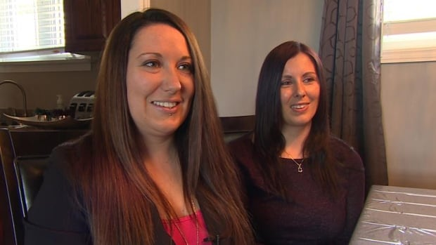 Same-sex couple Nicole White and Pam Renouf were sad and upset to learn that the store where they're buying their engagement rings recently put up a sign saying that marriage should be between a man and a woman.