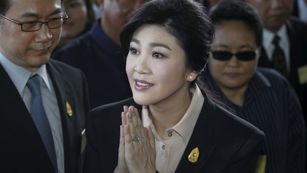 Ousted former Thai Prime Minister Yingluck Shinawatra gestures as she arrives at court in Bangkok on Wednesday.