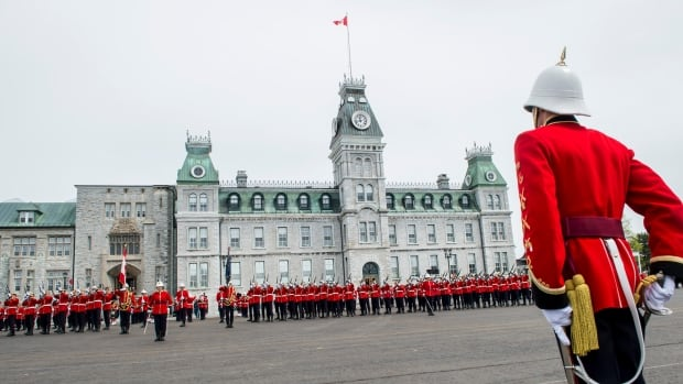 A graduating cadet stands at attention at the Royal Military College of Canada commissioning parade to salute the graduating class in Kingston, Ont. May 15.