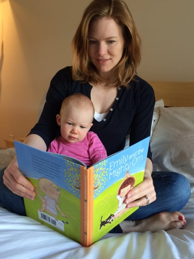 Sarah Lolley with her daughter and her book, Emily and the Might Om