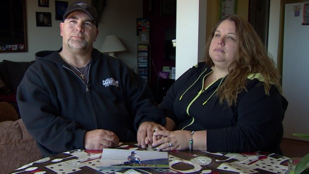 Malcolm Eyjolfson and Kerri Workman sit with a photo of their son. He died in October as a result of the choking game.