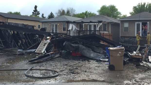 A fire destroyed two garages in Regina on Sunday, but firefighters said the situation could have been worse due to a fuel tank inside one of the garages.