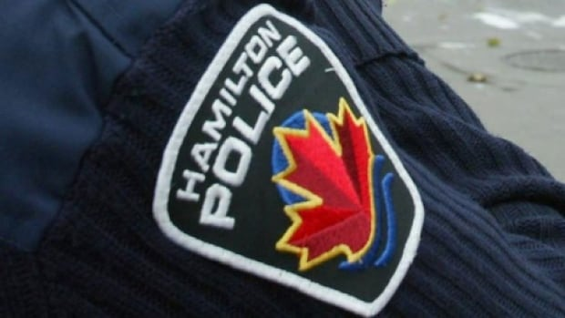 A Hamilton police officer has been demoted over an incident where he had sex with a woman he met on duty.
