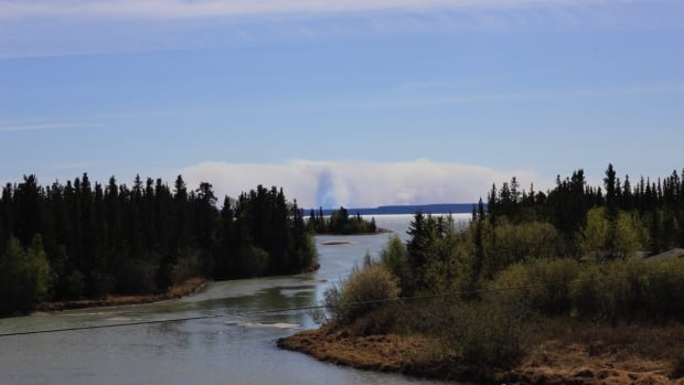 Smoke from a forest fire is visible May 25 from N.W.T. Highway 3 outside Behchoko.