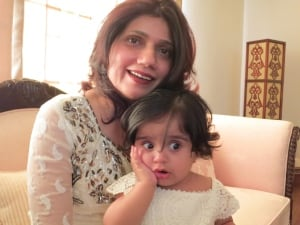 Nusrat Munshi with child Aleeza