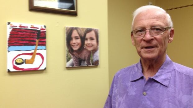 Ottawa Senators general manager Bryan Murray, seen here in his office at the Canadian Tire Centre with a photo of his granddaughters and a piece of their art, plans to work a few more years in hockey as he battles Stage 4 colon cancer.