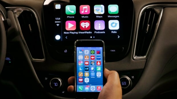 Starting with Chevrolet this summer, many General Motors models will offer Apple's CarPlay and Google's Android Auto systems that link smart phones with in-car screens and electronics. Here, an iPhone is connected to a 2016 Chevrolet Malibu equipped with Apple CarPlay apps, displayed on the car's MyLink screen.