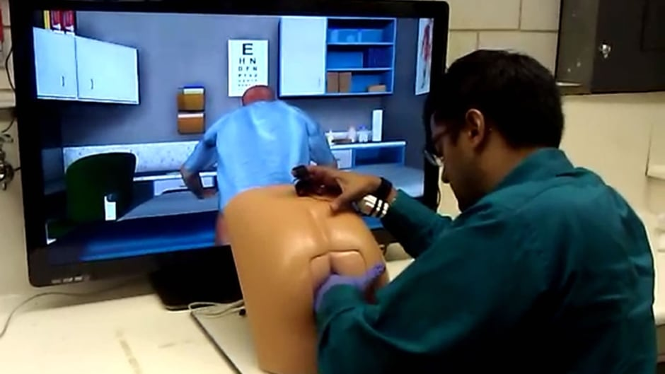 """A student giving a virtual prostate exam to """"Patrick."""""""