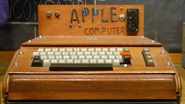 A fully assembled Apple I computer, with a homemade wooden computer case.