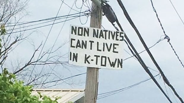 This sign is posted on a telephone pole in Kahnawake.