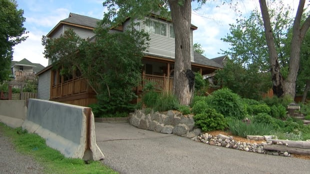 Neighbours in Britannia Park are pitted against each other over concrete barriers and a front-yard garden. Now the City of Ottawa has stepped in, ruling that both neighbours are violating bylaws.