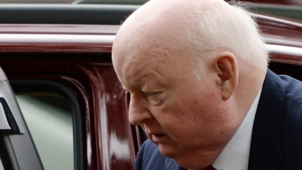 Suspended Senator Mike Duffy heads to court in Ottawa on Tuesday, June 2, 2015. Duffy faces 31 charges, including fraud, breach of trust and bribery.