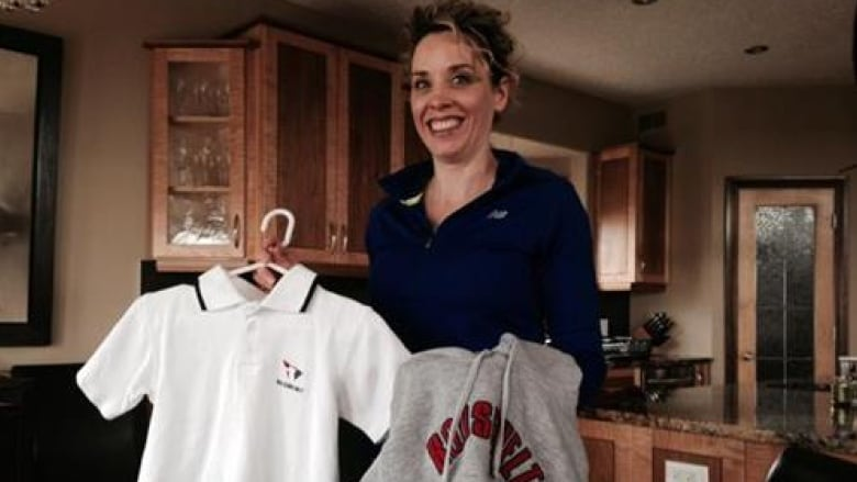 990bb7153e2 Brenda-Jayne Splett holds up some of the uniforms her three boys wore while  the family lived in Peru. They returned to Regina three years ago.
