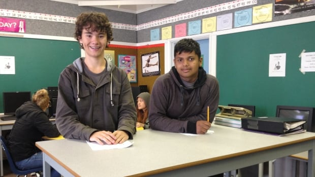 Shamus Kain and Rilesh Sharma take advantage of standing desks at New Westminster Secondary School.