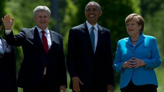 Perceptions of Canada's role in the world is shifting. Canadian Prime Minister Stephen Harper, United States President Barack Obama and German Chancellor Angela Merkel attend the G7 Summit in Germany, June 7.