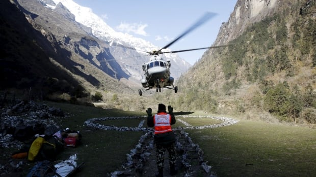 A helicopter arrives at a trekkers camp on an evacuation mission last month near Dhunche, Nepal.
