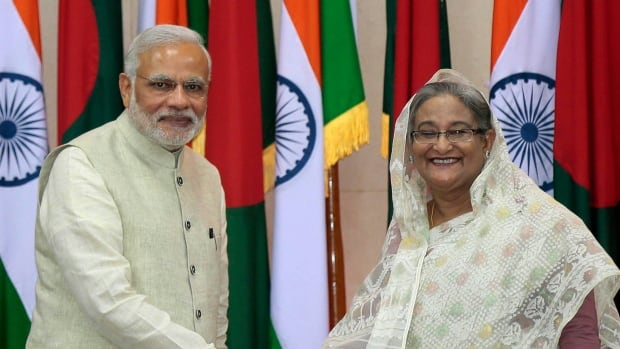 Indian Prime Minister Narendra Modi, left, and Bangladesh's Prime Minister Sheikh Hasina shake hands in Dhaka, Bangladesh, on Saturday.