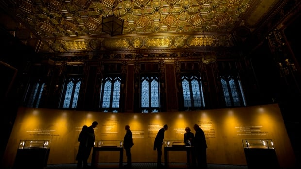 People look at the four surviving original parchments of the 1215 Magna Carta, displayed to mark the 800th anniversary of its sealing at Runnymede in 1215, in the Queen's Robing Room at the Houses of Parliament in London, Feb. 5.