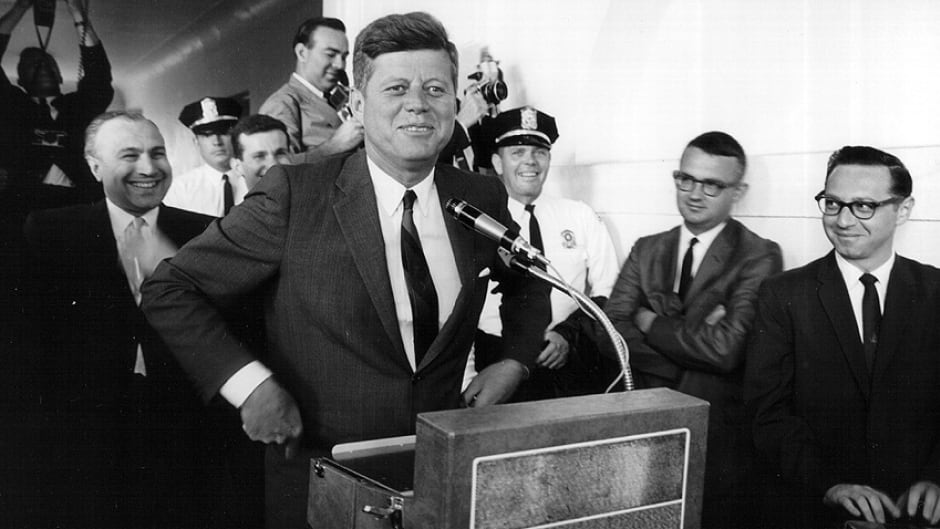 President John F. Kennedy laughs during a press conference June 11, 1963.