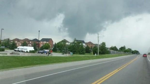 Andy Davies captured this image of what appears to be a funnel cloud touching down in Keswick, Ont., just south of Georgina. Environment Canada is now investigating to see if this was, in fact, a tornado touching down.