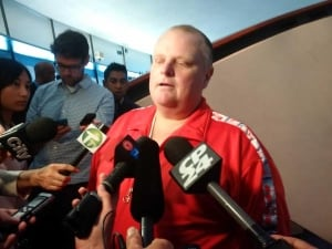 Rob Ford, wearing a red jumpsuit