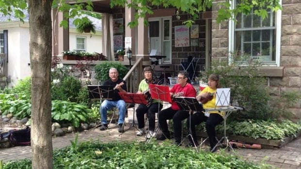 Kitchener is hoping making it easier to get a noise exemption will mean neighbourhoods will have more events, like this ukulele sing-along with Grand River Horizons Ensembles, which was part of the Grand Porch Party in 2013.