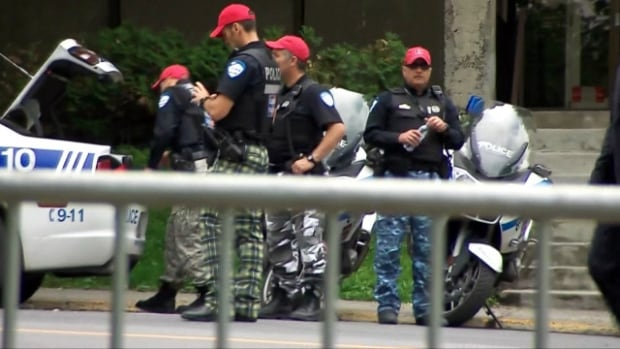 Montreal police to ditch camo for Angélil funeral ...