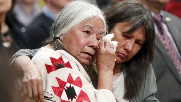 Residential School survivor Lorna Standingready (L) is comforted during the Truth and Reconciliation Commission of Canada closing ceremony at Rideau Hall in Ottawa, June 3. The TRC says the residential school experience amounted to cultural genocide.