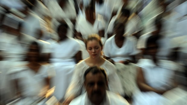 A foreign election observer (centre), together with Sri Lankan citizens, meditate during a special public meditation and prayer gathering organised for a peaceful election in Colombo on January 24, 2010.