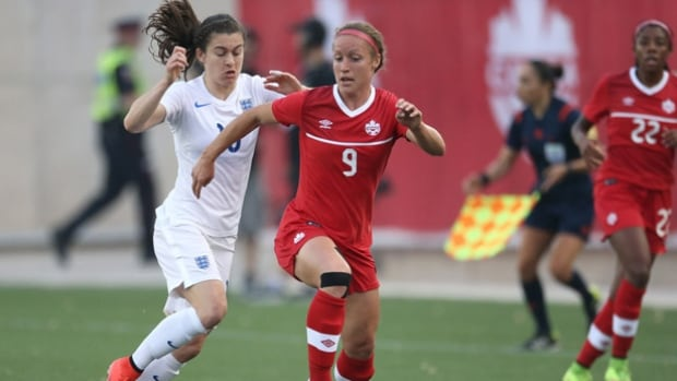 Josee Belanger, right, one of three Quebec players on Team Canada, has been waiting a long time for the chance to play at Olympic Stadium before family and friends. Canada takes on the Netherlands Monday.