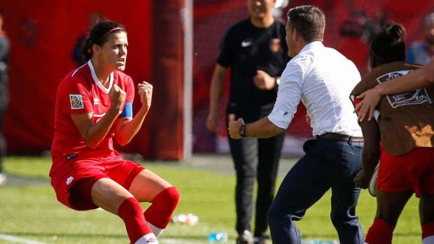 Christine Sinclair, shown heading towards coach John Herdman, has scored Canada's only goal in two World Cup matches, but is confident their chances to score are going to go in.
