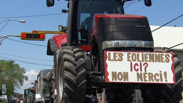 """Windmills here? No thank you!"" reads a sign at a protest in Quebec's Montérégie region against a proposed wind power farm."