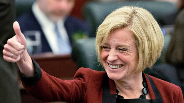 Premier Rachel Notley gave a thumbs up to the crowd at the Alberta legislature before the speech from the throne on Monday.