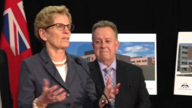 Ontario Premier Kathleen Wynne, flanked by MPP Michael Gravelle, told reporters on Monday that her government has already made some progress on the Ring of Fire mining project in northern Ontario.