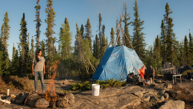A fire roars at Dechinta's outcamp, located on Blachford Lake, in the Northwest Territories. Dechinta offers programs twice a year, in the fall and the spring, along with shorter courses in the summer. Now, it's partnering with UBC.