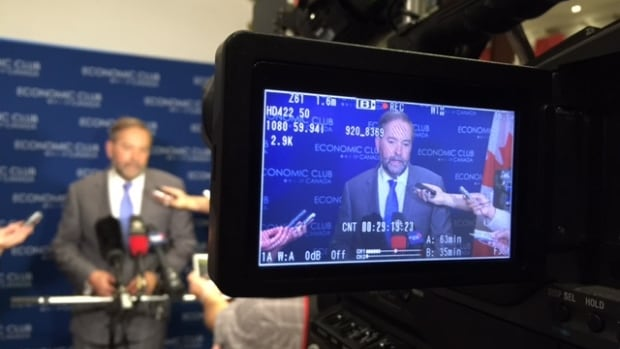 NDP Leader Tom Mulcair met reporters after his speech but found himself not only discussing his own policies but the competing platform of Liberal Leader Justin Trudeau as well.