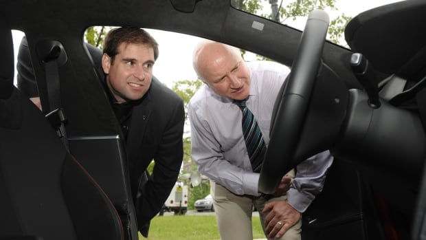The automotive and energy storage company's chief technical officer, JB Straubel (left), signed the agreement with Dalhousie lithium-ion battery pioneer, Dr. Jeff Dahn (right) in Halifax on Tuesday.