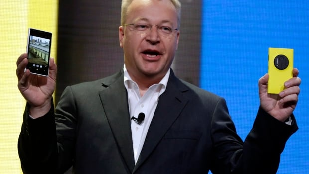 In this July 11, 2013 file photo, then-Nokia CEO Stephen Elop shows the company's Nokia Lumia 1020, in New York. Elop has been named the distinguished engineering executive in residence at McMaster University's faculty of engineering.