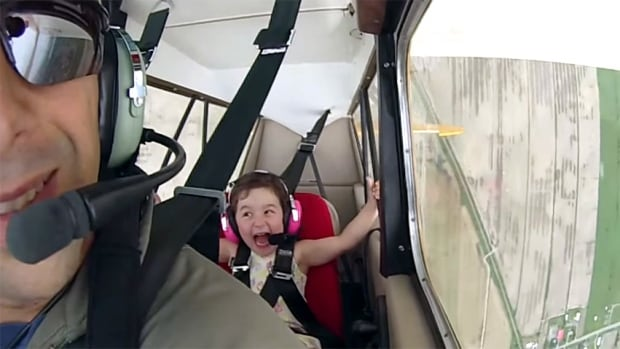 Four-year-old Léa Langumier of Quebec was more than ready for her father to perform aerobatic moves.