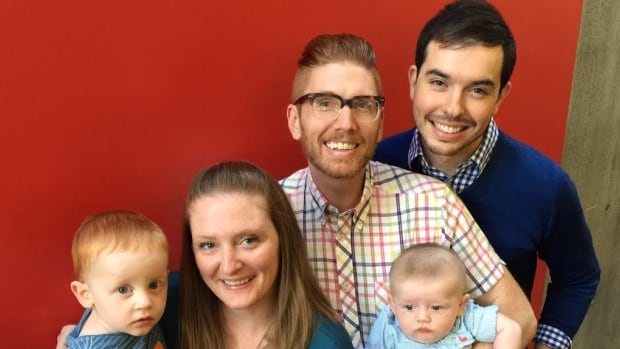 Craig Parkes (right) and Matthew Hinton were able to have their son, Fitzgerald, thanks to Matt's sister Laura agreeing to act as a surrogate.