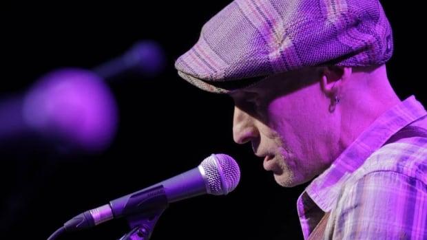 Spirit of the West lead singer John Mann in concert.