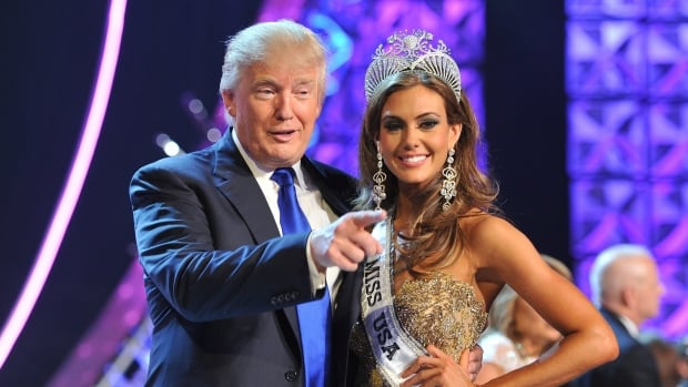 Donald Trump, left, and Miss Connecticut USA Erin Brady pose onstage after Brady won the 2013 Miss USA pageant in Las Vegas. NBCUniversal, who has partnered with Trump in his Miss USA, Miss Universe and Miss Teen USA pageants since 2003, is backing away from controversial comments he made about Mexican immigrants.