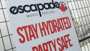 Escapade Music Festival sign: Stay Hydrated, Party Safe