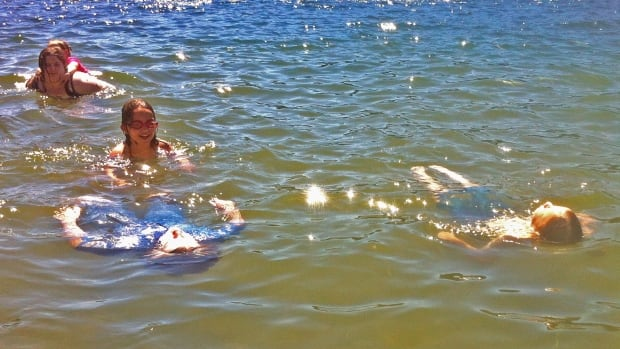Swimmers cool off during the B.C. heatwave in Canada's warmest lake, Sasamat.
